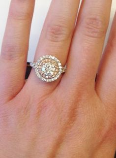 Double halo engagement ring for a round diamond with an inner halo of fancy pink diamonds set in rose gold. Available in 14k, 18k, palladium and platinum.