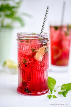 Mojito (mint, lime wedges, simple syrup, raspberries, white rum, cherry brandy or Chambord, and tonic water or soda water)