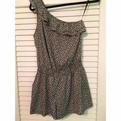 Forever 21 Romper One shoulder romper with ruffle detail. Black and white floral design. Elastic waistband and pockets on sides. Super cute and comfortable. Worn but good condition! 100% polyester Forever 21 Pants Jumpsuits & Rompers