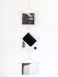 Coat hangers for hanging magazines