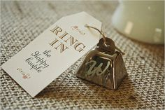 """Bells for exit. With tags that say """"ring in the happy couple."""""""