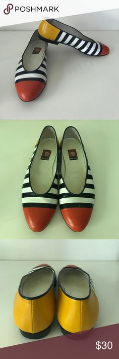 Anne Klein striped colorblock ballet flats Adorable made in Italy Anne Klein ballet flats. Red toes yellow heel and navy/white stripes in between. Leather. Worn a few times but great condition and clean. Anne Klein Shoes Flats & Loafers