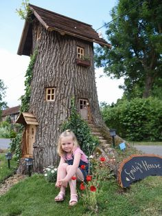 Poppy Robinson, 4, with Emily's House, the fairy tree in her grandad, Neil Rafis' front garden at Wreningham, which he made from an oak tree stump. Neil hopes that people will come and visit, take pictures and make a donation to EACH in memory of their friends' daughter, eight-year-old Emily Rush, who died in 2015. Picture: DENISE BRADLEY