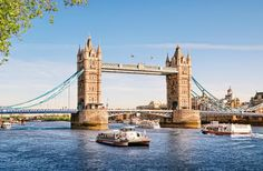 Tower Bridge -London. A combination bascule and suspension bridge, this Gothic-style landmark gives visitors passage across the Thames. Construction of the Tower Bridge began in 1886 and took eight years to complete; it's well known for its rising roadways that allow ships to sail beneath.