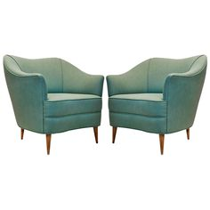 Pair of Upholstered Lounge Chairs by Gio Ponti | From a unique collection of antique and modern lounge chairs at https://www.1stdibs.com/furniture/seating/lounge-chairs/