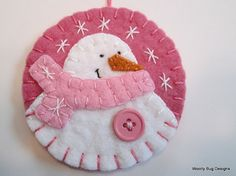Wool Felt Snowman Ornament, Rose Pink Background, Light Pink Scarf, Pink Button, Snowflakes from Woolly Bug Designs on Etsy