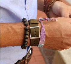 Weathered bracelets on a guy .. shows he's been places <3