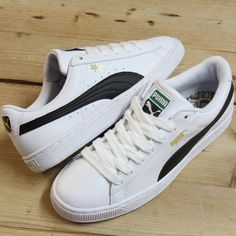 0cfccb381a364 Fresh White leather Puma Basket trainers with contrast black stripe and  gold writing providing a stunning