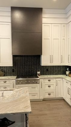 Gorgeous cream colored kitchen with cabinets to the ceiling and leathered granite countertops