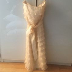 Betsy johnson strapless cream ruffle dress Great for prom or any fancy occasion! Tiered ruffles add elegance. Comes with a belt that can be removed. Some self tanner stains at the top as seen in the second photo. Betsey Johnson Dresses Strapless