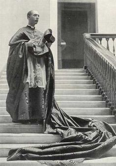 A Prince of the Church; Cardinal Schuster. The long silk moire train of the cappa magna was carried by a server.