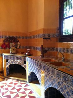 Mexican Kitchens With Arch Front Kitchen Storage With Wrought Iron Doors And Ceramic Backsplash And Countertop And Wooden Wall Mounted Cabinets : Stunning Mexican Kitchens Mexican Style Homes, Mexican Style Kitchens, Mexican Kitchen Decor, Mexican Home Decor, Farmhouse Kitchen Decor, Decorating Kitchen, Mexican Hacienda, Hacienda Style, Design Seeds