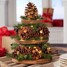 26 DIY Christmas Pine Cone Crafts To Add Extra Charm To Holidays Pinecones Christmas Tray Decoration Tree Centerpieces, Pine Cone Decorations, Christmas Table Decorations, Holiday Decor, Pine Cone Christmas Tree, Deco Table Noel, Pine Cone Crafts, All Things Christmas, Diy Christmas
