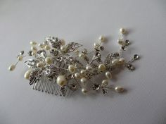 I have used varies sizes of freshwater pearls to make this comb interesting and flowing. This took great time and much thought to create this