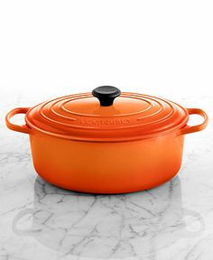 Le Creuset Signature Enameled Cast Iron 6.75 Qt. Oval French Oven - All Le Creuset - Kitchen - Macy's in the color flame