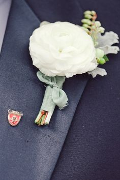 simple white boutonniere with a soft aqua tie | The Nichols #wedding