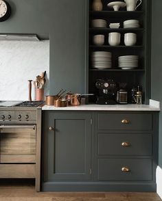 'Flint' coloured cupboards and walls and warm hints of copper make for the cosiest kitchen. #deVOLKitchens