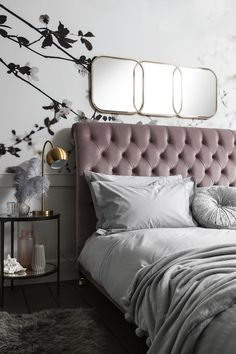 MADEHURST BED  Upholstered in delicate dusky lilac velvet, the Madehurst bed features rows of deep buttoning and a ruched rolled top design for a decadent finish that sets the Romantic mood in your home. See more from Mood Collections.