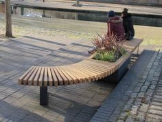 RailRoad 470mm high planter in mid-position of one curved bench and one straight…