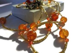 Made with energy and determination, I'm ready 2018!: Fire Agate, jade rose stone, and glass beaded double wrap necklace http://etsy.me/2DLYppI #jewelry #necklace #gold #EtsyHunter #toggle #flower #gemstone #yes #orange #jewelryonetsy #shopetsy #handmade #fireagate