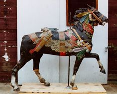 Dentzels Indian Pony BEFORE restoration, with several coats of paint to be removed.