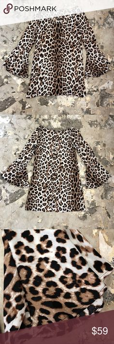 The Vanity Room Leopard print cocktail dress An extremely unique piece that is killer on! This product is new without tags and has never been worn, excellent condition! The sleeves make this dress amazing with their feminine and bold look. The chest area of the dress has seems to give a great fit! This piece is made for that rock and roll lover!! The Vanity Room Dresses