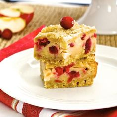 Apple Cranberry Pie Bars are thick pie bars with fresh apples and cranberries in a tangy, Greek yogurt filling.