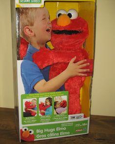 Adorable Big Hugs Elmo. He says more than 50 words and sounds. He'll sing you a lullaby and he'll hug back when you hug him! #elmo #hugs