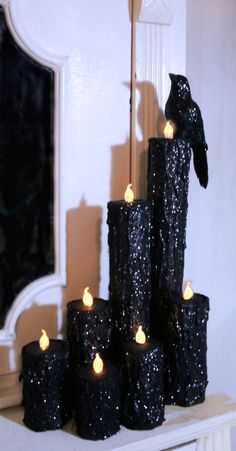 Paper towel rolls painted black with glitter. I don't know what I could use as the wax drippings. Maybe real wax drippings? :P Idk. And LED tea lights.