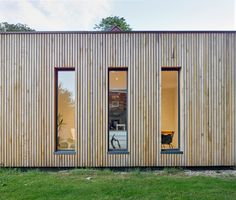 English oak board cladding from Vastern timber. Contemporary, Pre-Fabricated Extension to a Grade Two Listed House — Adam Knibb Architects