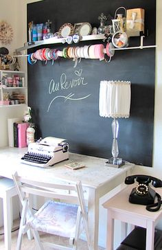 what a cute craft area! Chalk board would be a great for me to get organized!