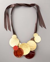 Like a solar system science-fair project gone awry - in a good way. Herve Van Der Straeten Disc & Ribbon necklace.