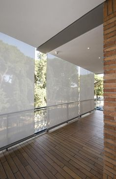 Vertical shades for the deck -- Casa O by Alvisi Kirimoto + Partners