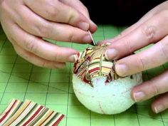 Quilted Ball Ornament Tutorial--Useful hint--put first pin slightly off center so that the point will be sharp. She also divides the ball into quarters using 3 rubber bands and then marks them.