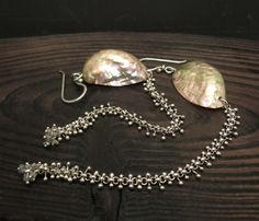"""Victoria Takahashi: , Earrings in sterling silver, abalone shell, and 16 raw diamonds. 5"""" in length."""