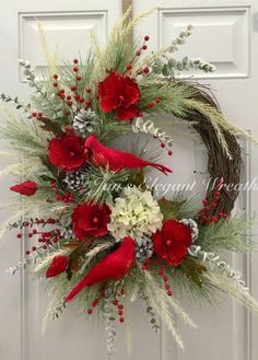 I would classify this exquisite Christmas wreath to be in the glamour category. The grapevine wreath base is covered about of the way around with icy pine branches. 4 bright red glittered velvet poppies, along with a cream colored iced hydrangea decora Elegant Christmas, Noel Christmas, Rustic Christmas, Christmas Ornaments, Southern Christmas, Christmas Swags, Christmas Nativity, Beautiful Christmas, Handmade Christmas