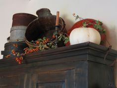 Bittersweet and pumpkins - nice top of cupboard arrangement for fall...great
