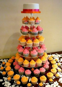 Bright orange and pink wedding cupcake tower - so cute! #wedding #neon #pink #weddingcupcakes #cupcaketower