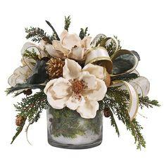 Faux cedar and magnolia arrangement in a glass vase. Features curling ribbon accents.  Product: Faux floral arrangement...