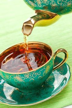 tea green and gold tea cup & saucer