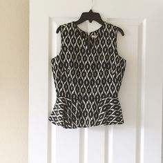 Host Pick  NWT Peplum Top Sophisticated peplum black & ivory top. New with tag (NWT). Tops