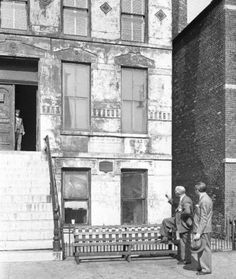 A 1946 photo of 558 Dekoven St, presumed to be the origin point (Mrs. O' Leary's Barn) of the Great Fire of 1871. Looks like there is a plaque on the front of the house. Does anyone know if there are any markers currently? It's a parking lot now.
