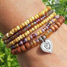 Topaz Rainbow - Beaded Stretch Stack Bracelets with Heart Charm via Etsy