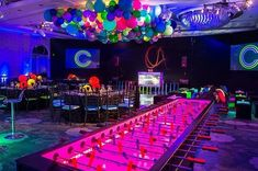 At this fun neon Bar Mitzvah guests could either be found enjoying themselves on the dance floor to the tunes played by @CheckOne2Ent or battling friends on the extra-long foosball table.|| Venue: @fslosangeles | Photography: @John_Solano_Photography | Design & Production: @jowyproductions | Lighting/Dance Floor washes: @thelightersidela | Balloons: @BalloonCelebrations | Dance Floor & Risers: @barkerdecor | Floral: @CJMatsumotoflowers | Entertainment: @ #LaminateHardwoodFlooring Man Cave Flooring Ideas, Cheap Wood Flooring, Flooring Store, Laminate Flooring, Floating Vinyl Flooring, Balloon Dance, Bar Dance, Burgundy Wedding Cake, Minimalist Wedding Invitations