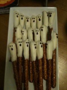 So easy!  White chocolate dipped pretzel rod ghosts.