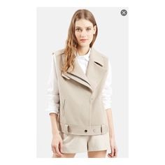 """Belted bike vest top shop by Nordstrom Notched lapels that release into an asymmetrical front closure and a belted hem authenticate the biker status of a boxy vest fashioned from a stretchy grey knit. 28"""" length (size 8). ( fits like 6-8) Front zip closure. Front slant pockets. 66% polyester, 30% viscose, 4% elastane. Machine wash cold, line dry. By Topshop; imported. Note; can't find anymore in store.my price is firm , sorry no accept offers Topshop Jackets & Coats Vests"""