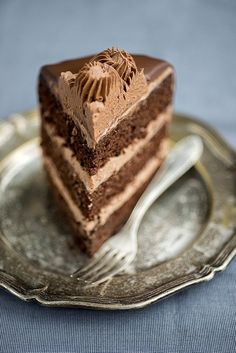 Ultimate Chocolate cake filled with whipped Nutella cream and smothered in chocolate fudge glaze | Supergolden Bakes