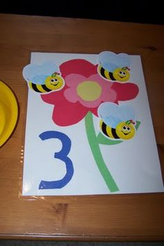 put the right number of bees on the flower. This would be fun to do Tree with apples, school bus with children in window or aliens in a space ship.