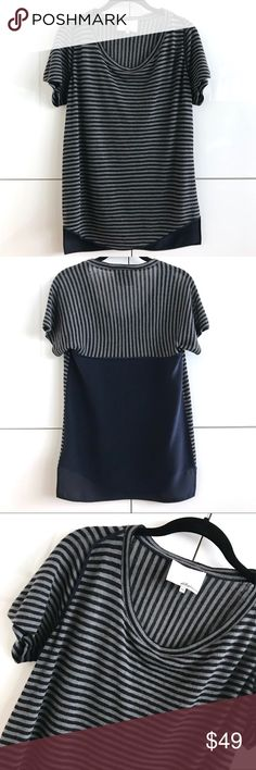 3.1 Philip Lim Wool/Silk Blend Striped Tee 3.1 Philip Lim Wool/Silk Blend Striped Tee.  Size XS.  Striped body is 100% wool and trim & lower back is in 100% silk.  Navy and grey.  Top is pre-loved, showing minor signs of wear (some piling on lower sides of wool portion of top, as reflected in last photo).  Aside from this, it is in very good condition. 3.1 Phillip Lim Tops