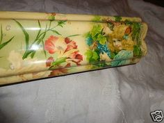 """ANTIQUE-VICTORIAN-CELLULOID-GIRL-PORTRAIT-GRAPES-FLORAL-HUMP-GLOVE-DRESSER-BOX. BIN: $98. (?)---Paper on sides/bottom replaced?? Jarring print compared to rest of box. But box still an example of an item to be aware of.....---- This is an old Victorian era celluloid top and paper sides stunning dresser box with an unusual rolled hump top. It features a beautiful child picking grapes with pink and red carnation floral background. The box is 11 1/2"""" by 3 1/2"""" by 3"""" tall. The celluloid top is…"""